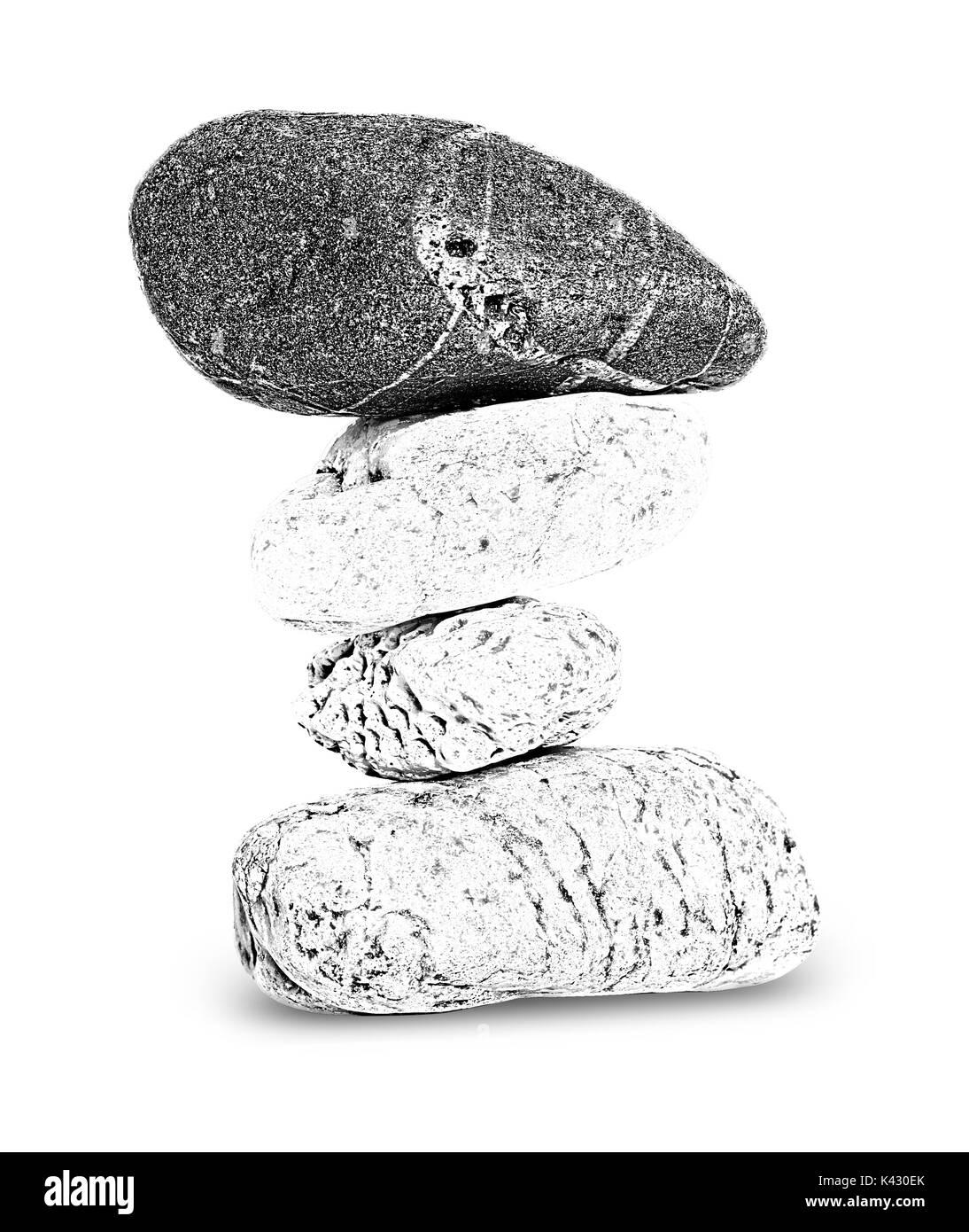 Balancing stone tower on white background - stone pyramid - Stock Image