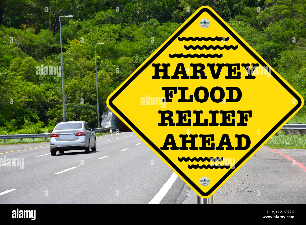 Harvey flood relief ahead, yellow warning road sign - Stock Image