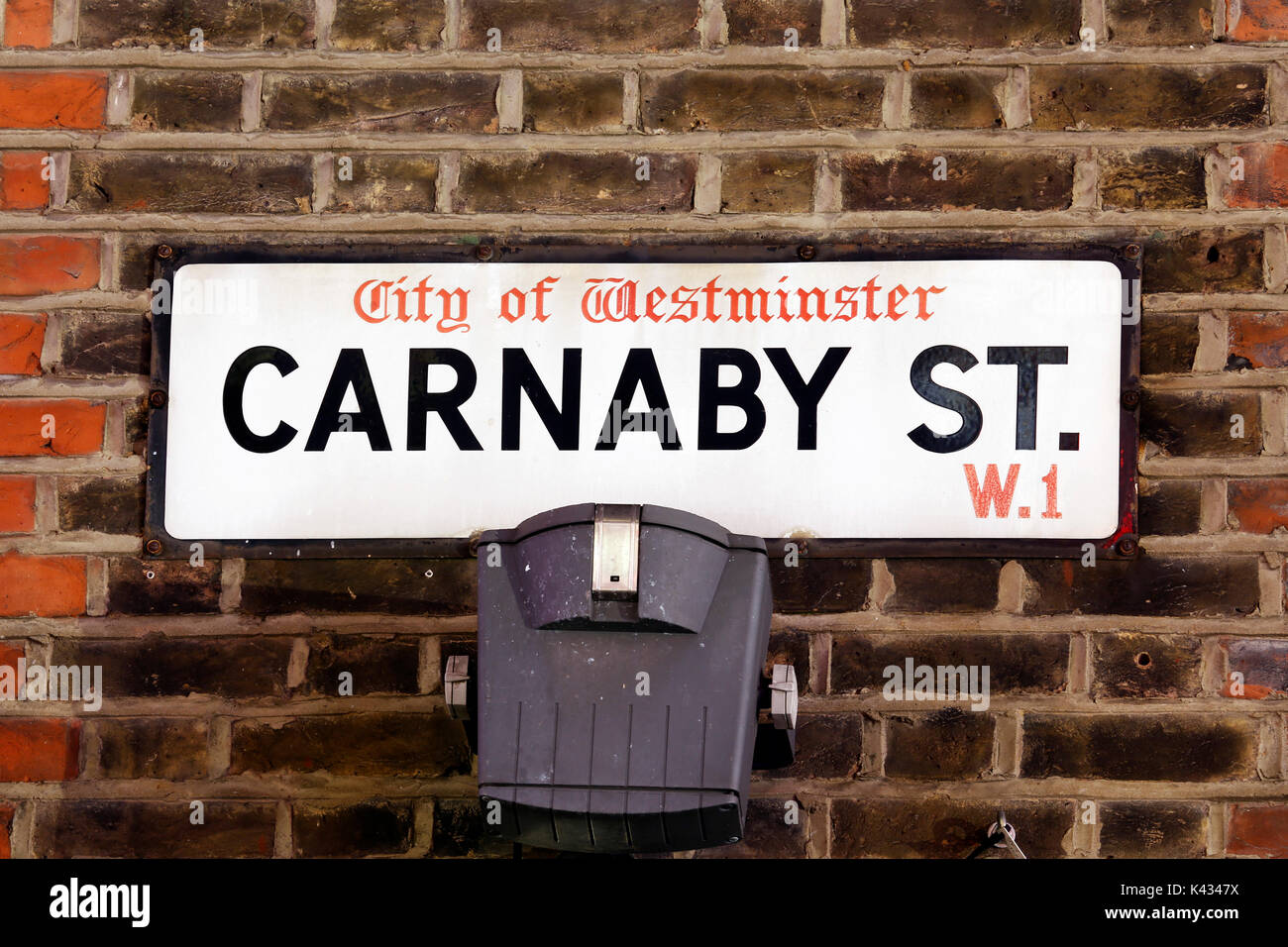 Street Sign of Carnaby Street, one of the London's major shopping streets,  completed in 1825, run through Piccadilly Circus and Oxford Circus. - Stock Image