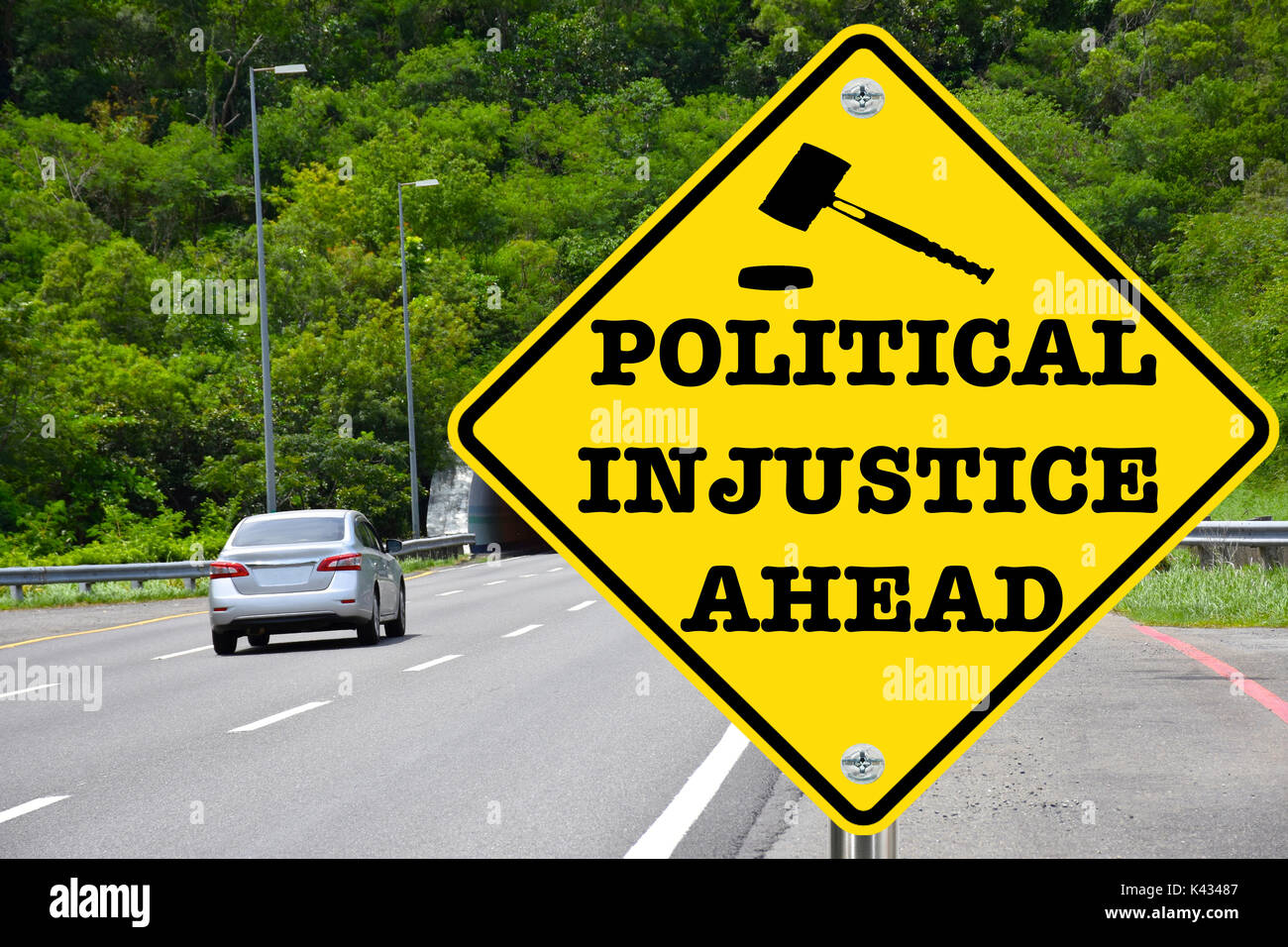 Political injustice ahead, yellow warning street sign - Stock Image