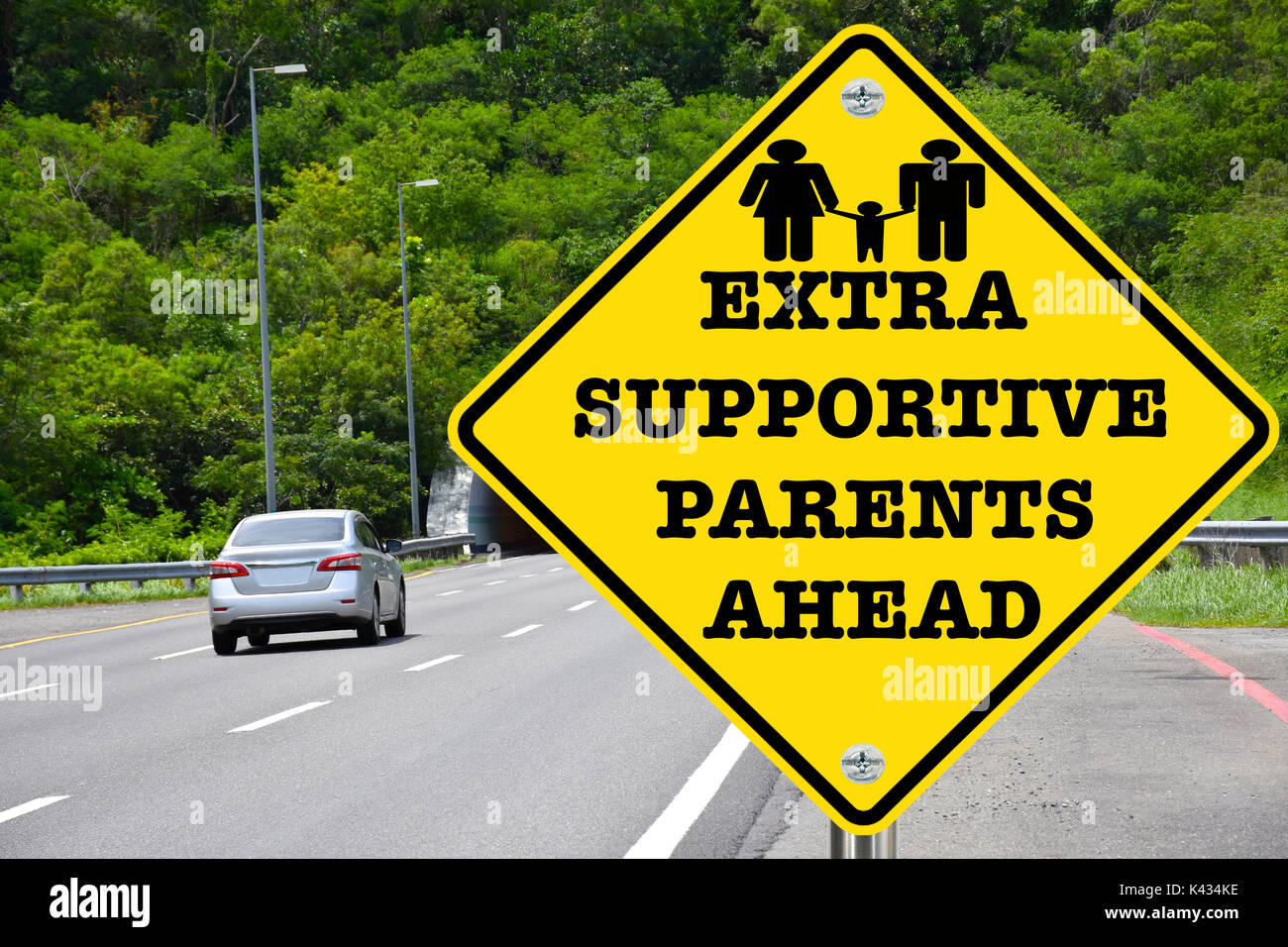 Extra supportive parents ahead, yellow warning road sign - Stock Image