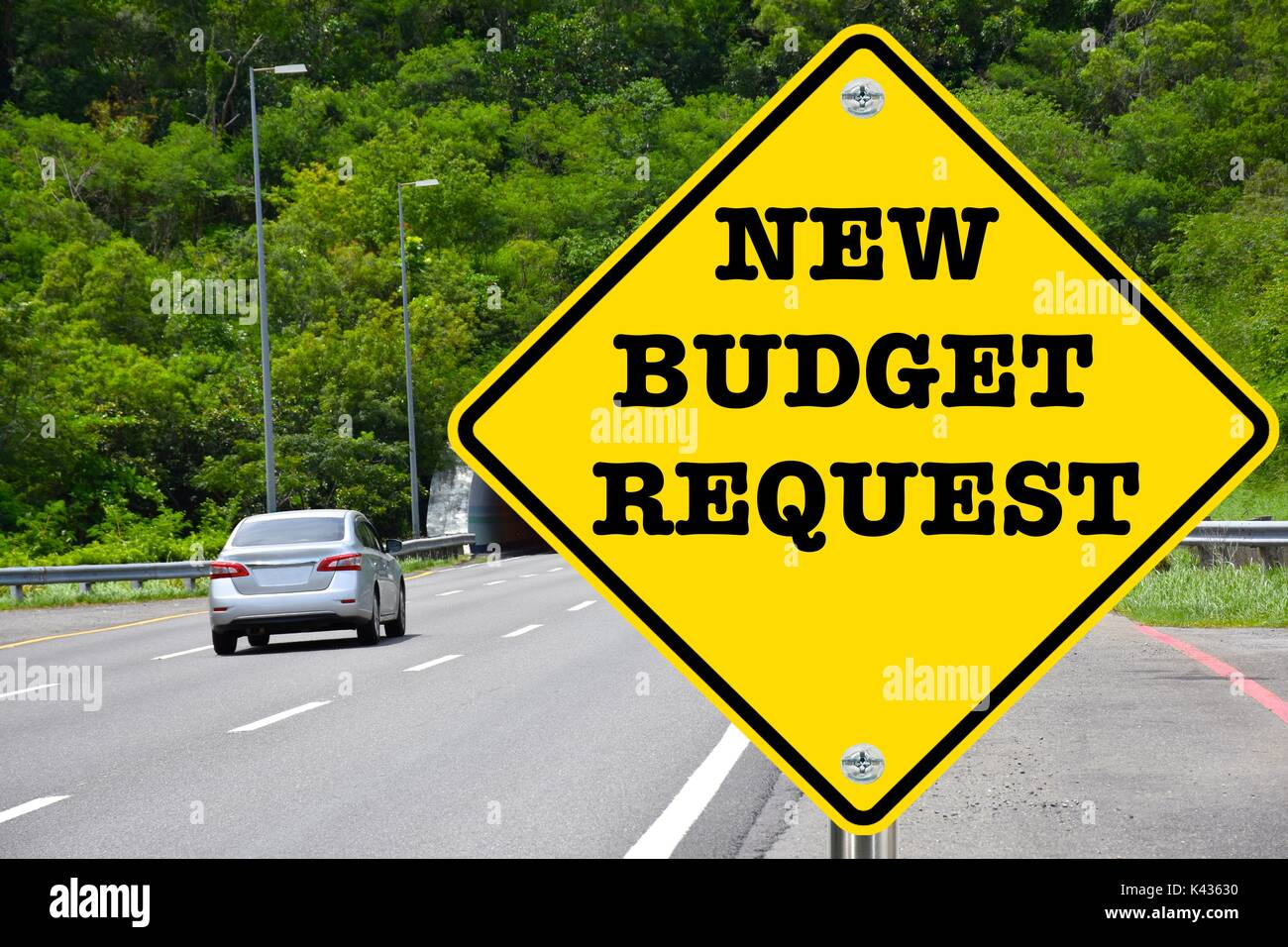 New budget request, yellow warning road sign Stock Photo