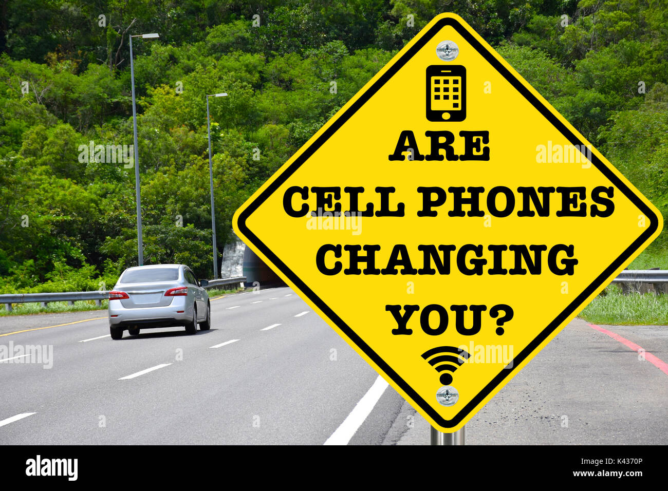 Are cell phones changing you? Addresses the social and tech evolution and human reliance and dependence on them - Stock Image
