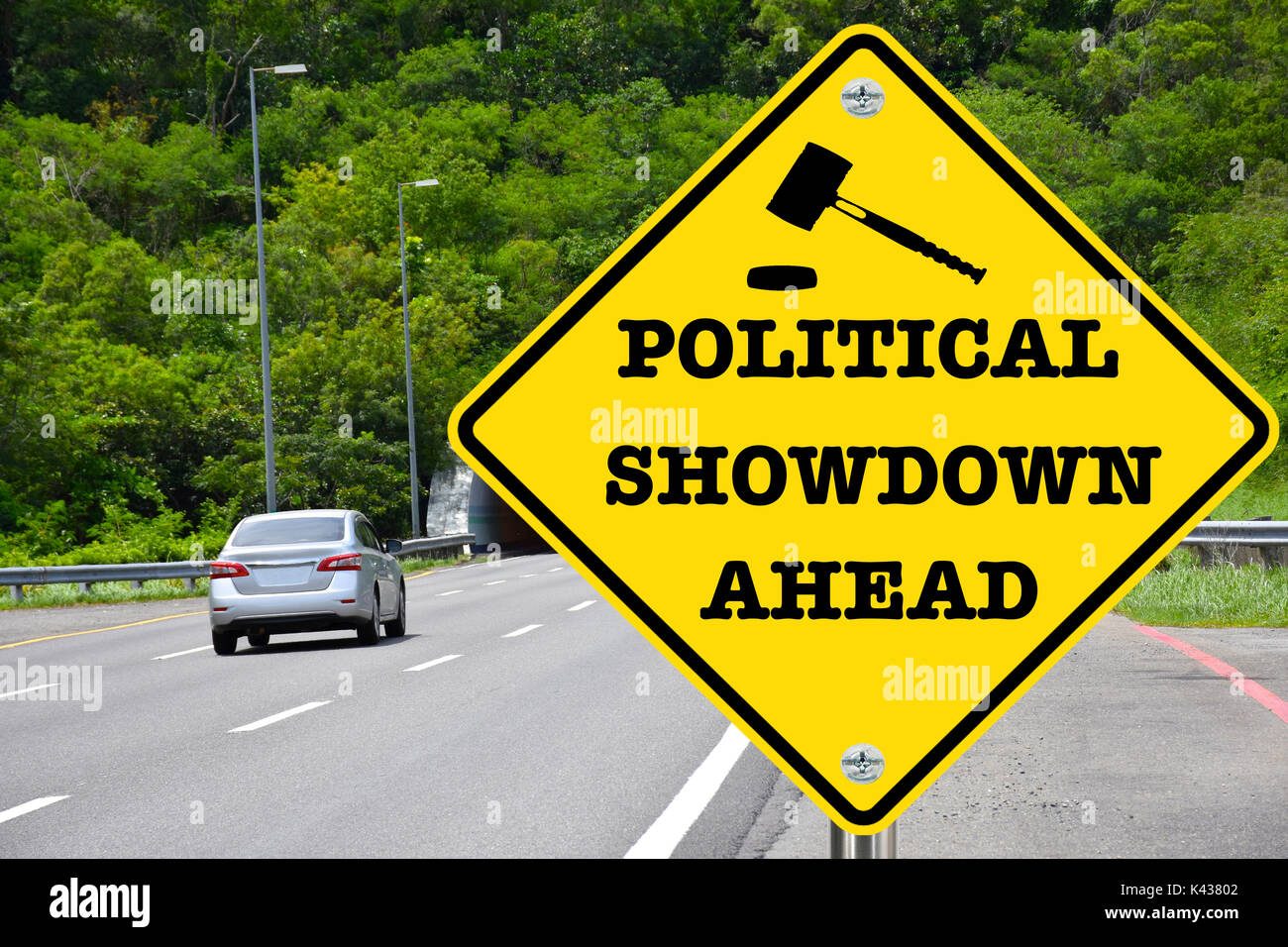Political showdown ahead, yellow warning road sign - Stock Image