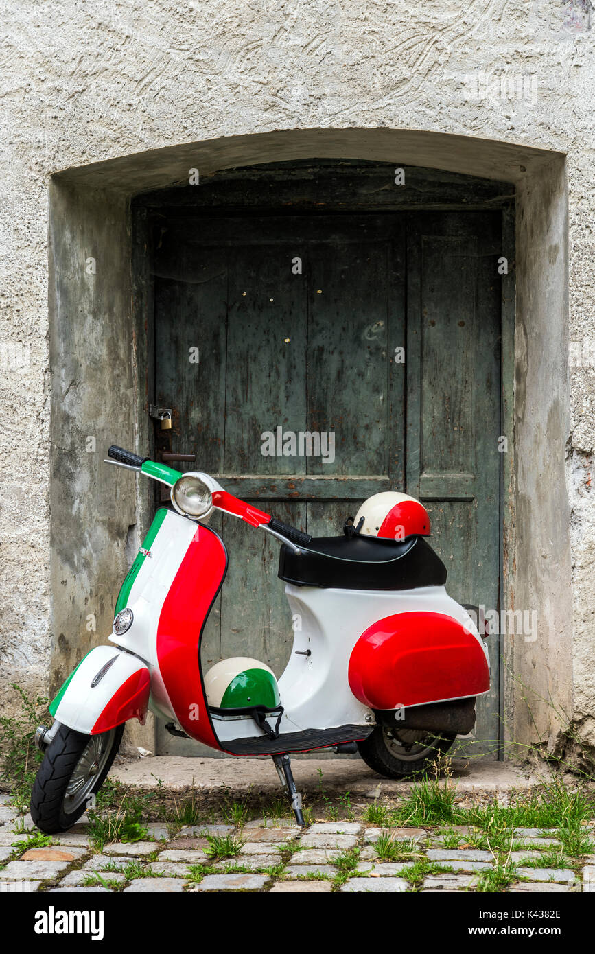 Parked Vespa scooter painted in Italian flag colors, Rome