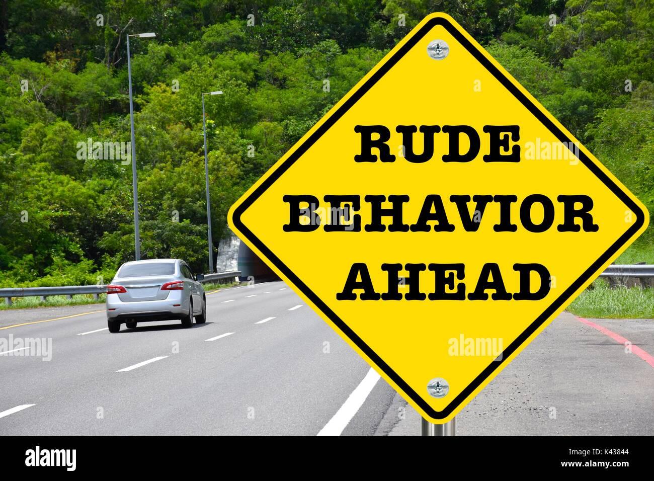 Rude behavior ahead, yellow warning road sign - Stock Image
