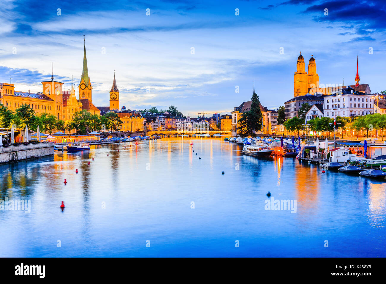 Zurich, Switzerland. View of the historic city center. Grossmunster Church and Fraumunster Church on the Limmat - Stock Image