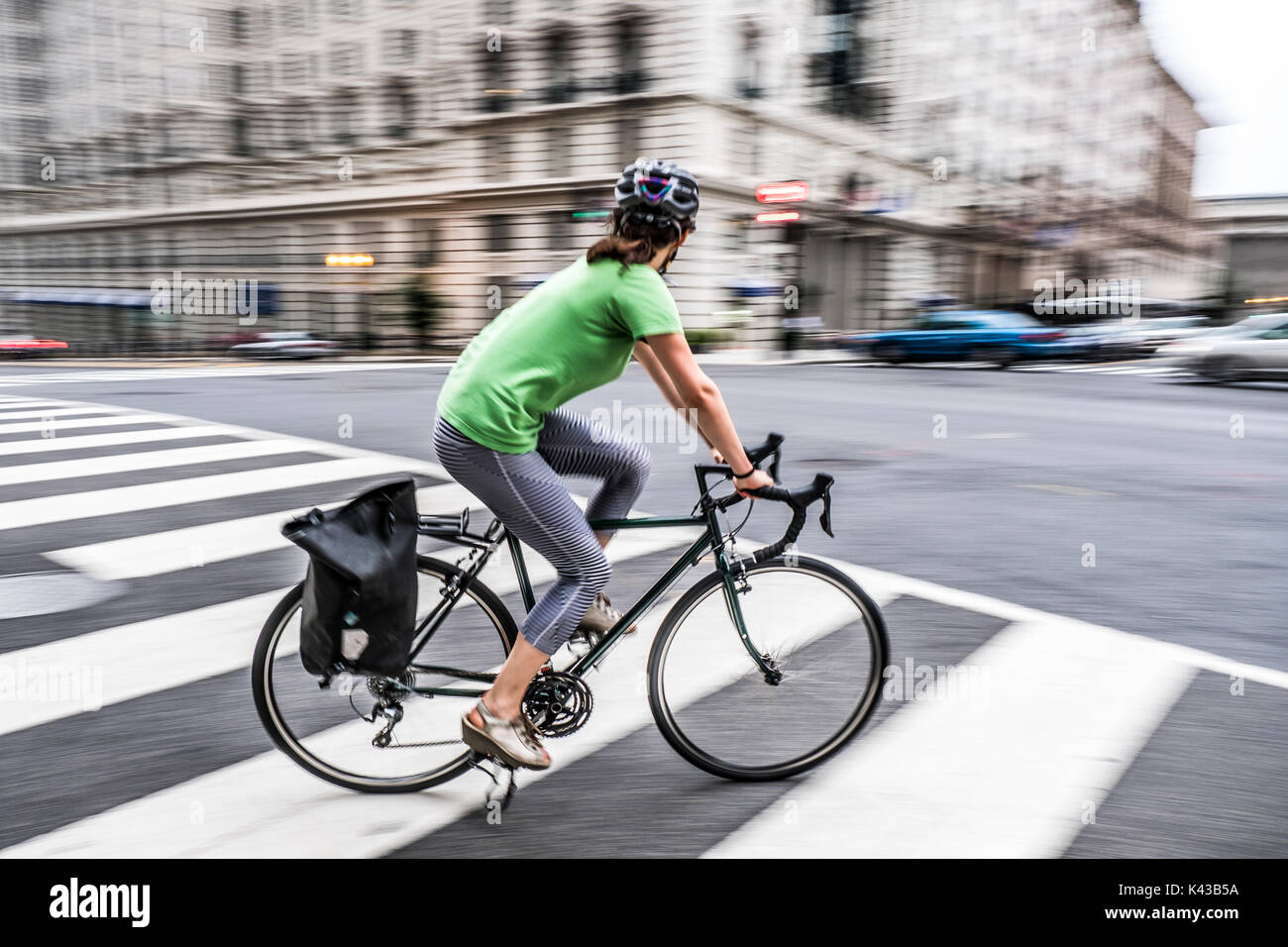 Abstract blur a cyclist riding in Washington DC city road - Stock Image
