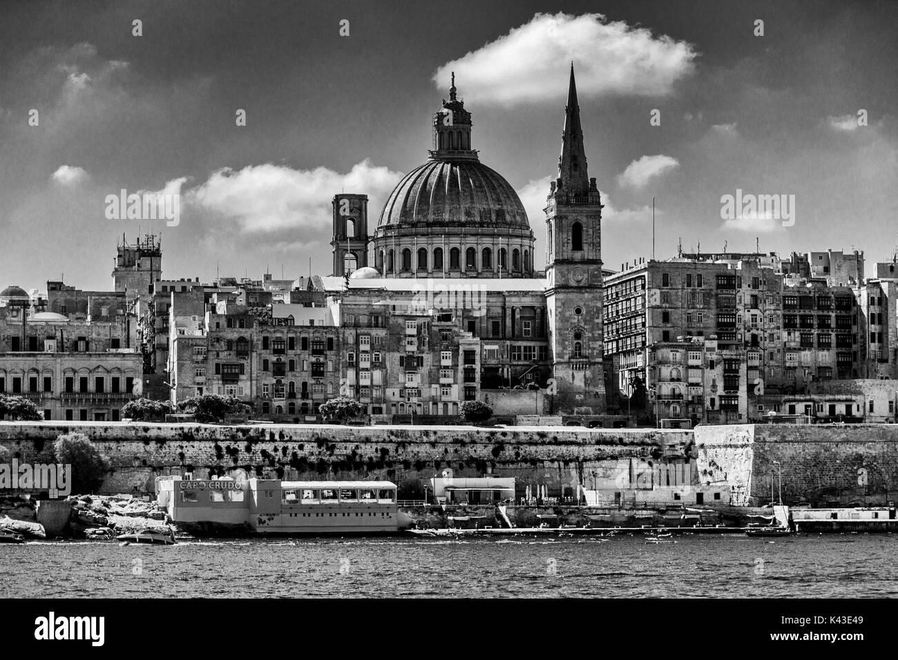 Black and white photograph of Valletta, capital of Malta, from Marsamxett Harbour - Stock Image
