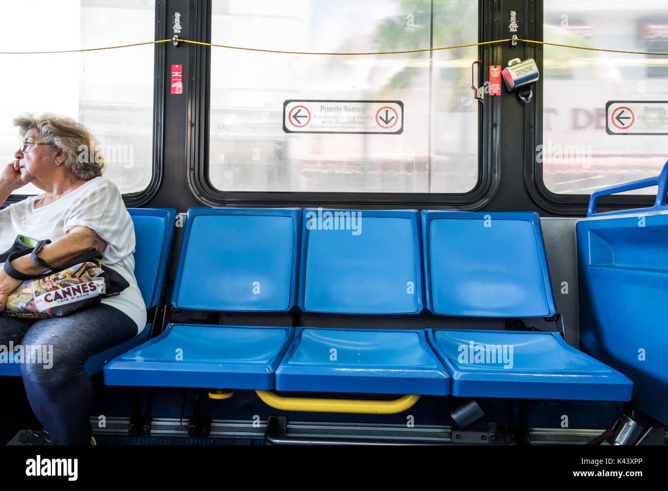 Miami Beach Miami Florida-Dade Metrobus public transportation bus interior seats senior rider passenger - Stock Image