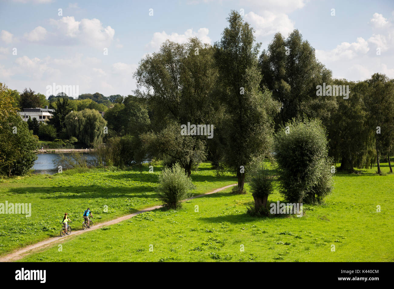 Cyclists on the floodplains of the river Ruhr in Mülheim an der Ruhr, Germany Stock Photo