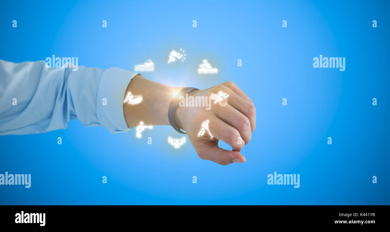 Cropped hand of man wearing fitness band against blue background - Stock Image