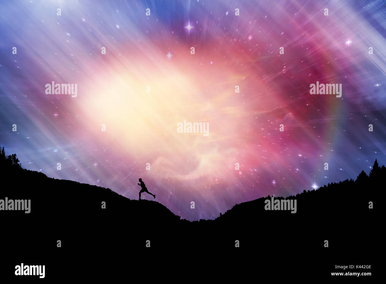 Male runner running against outer space - Stock Image
