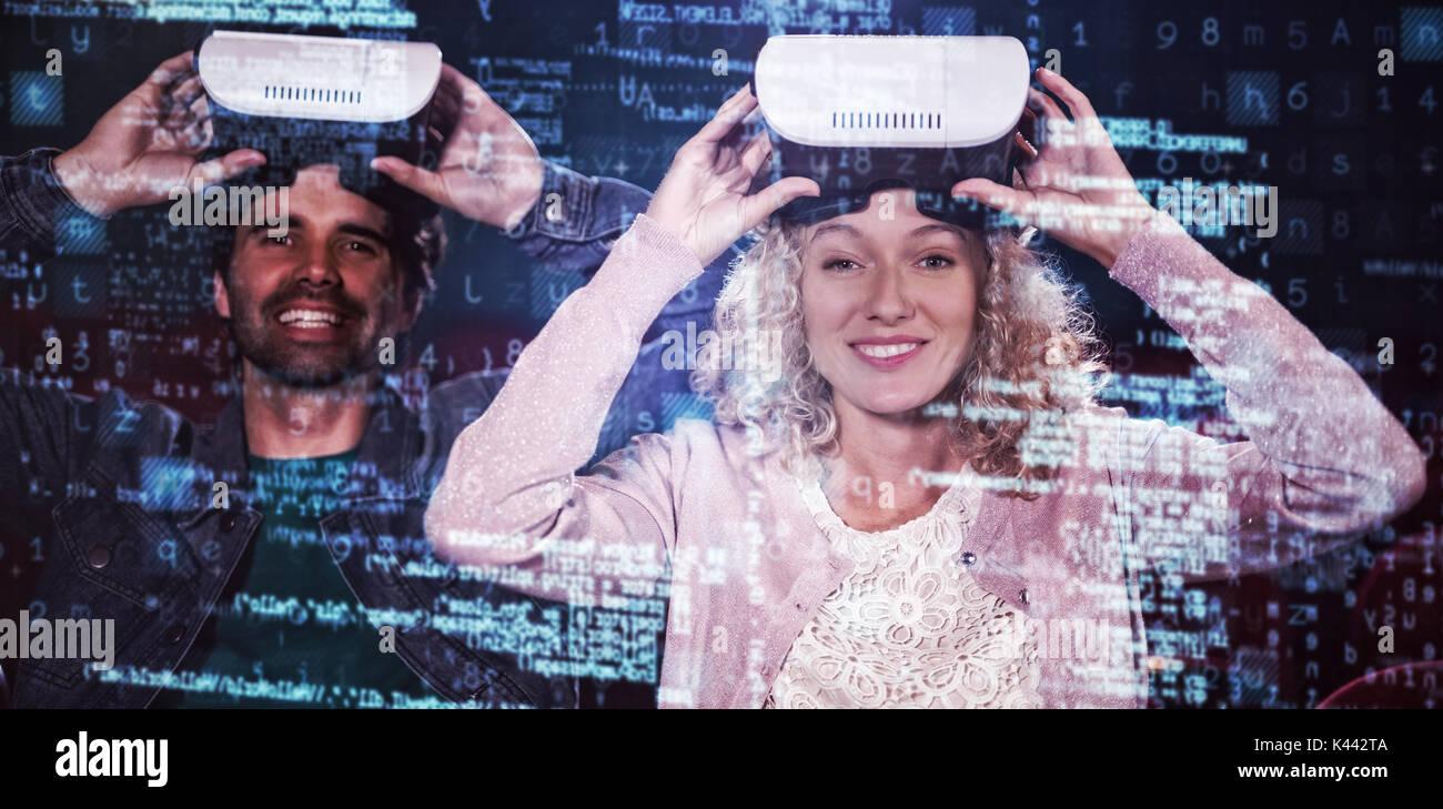 Image of data against couple using virtual reality headset - Stock Image