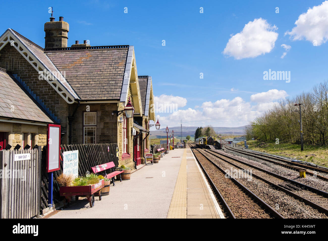 Passenger train stopped at Ribblehead station on Settle to Carlise railway line. Yorkshire Dales National Park West Riding North Yorkshire England UK - Stock Image