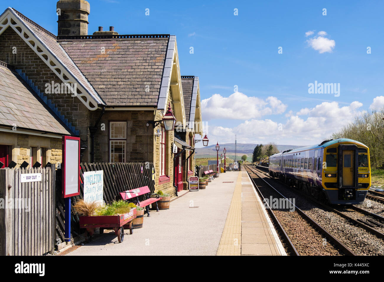 Passenger train leaving Ribblehead station on Settle to Carlise railway line. Yorkshire Dales National Park West Riding North Yorkshire England UK - Stock Image