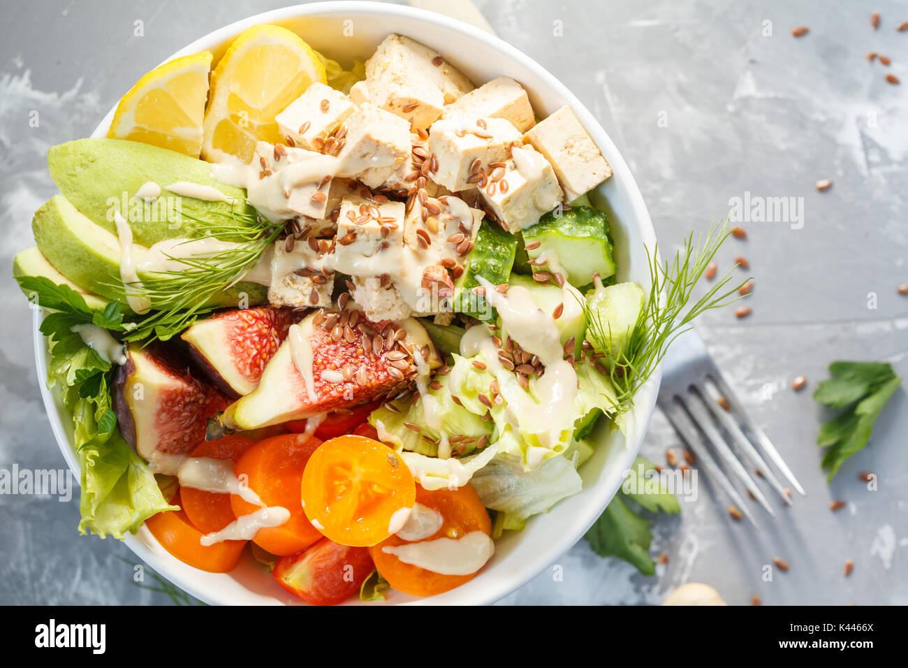 buddha bowl, vegan lunch, tofu fruit vegetables salad. - Stock Image