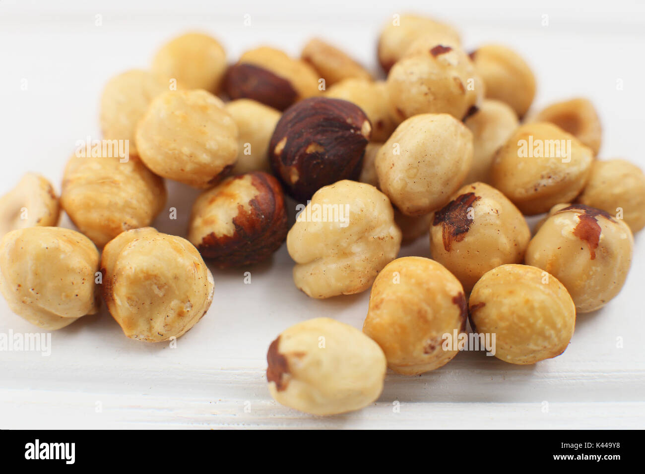 A bunch  hazelnuts on a white background. - Stock Image