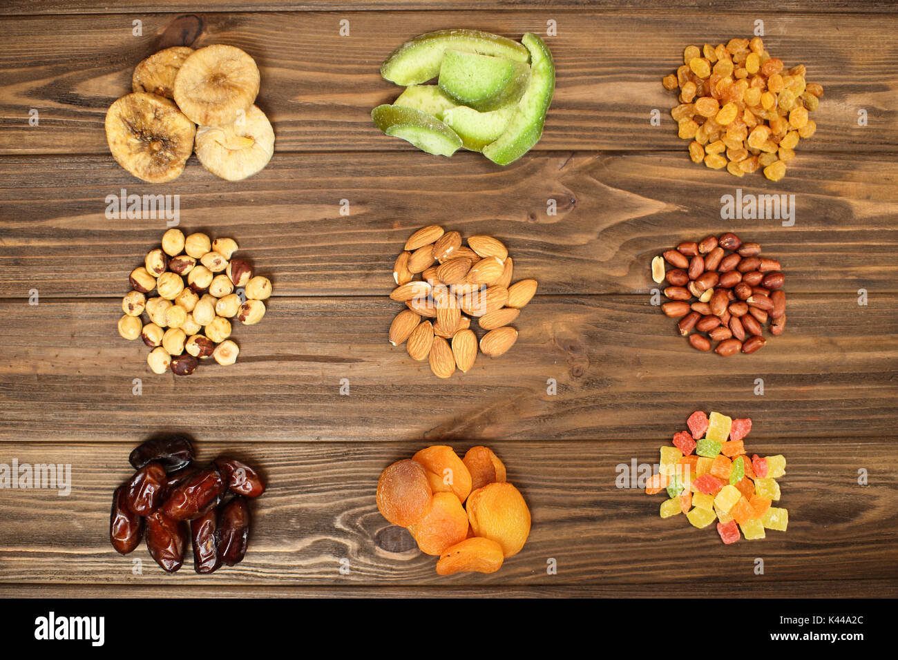 Nuts and dried fruits on wooden background . - Stock Image