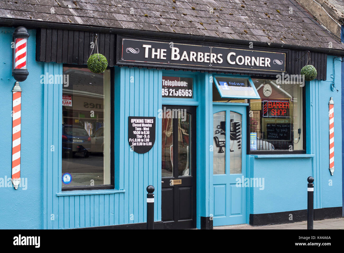 Barber Shop Front with Red and White Pole in Co.Clare Ireland - Stock Image