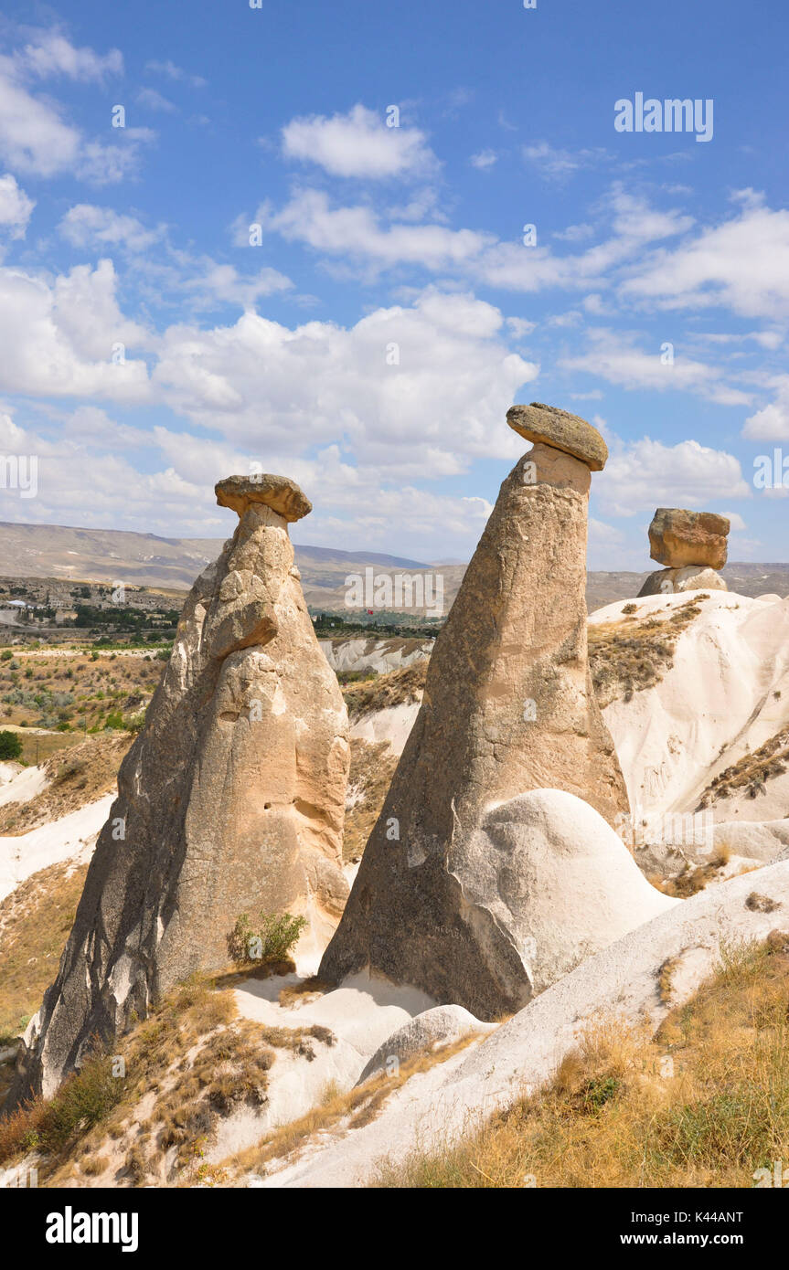 This small group of rock is located in the Region of Kapadokia region in Turkey near the town of Urgup, which is located about 20 km from Nevsehir. - Stock Image