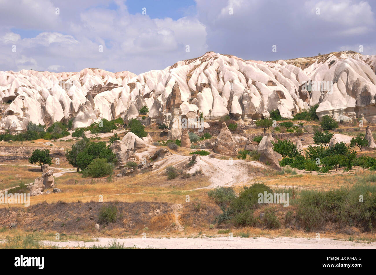 Part of region called Kappadokia in Turkey, you can see these fantastic formations called fairy chimneys. This particular area is near Uchisar in the middle of the street from Nevsehir and Goreme. - Stock Image