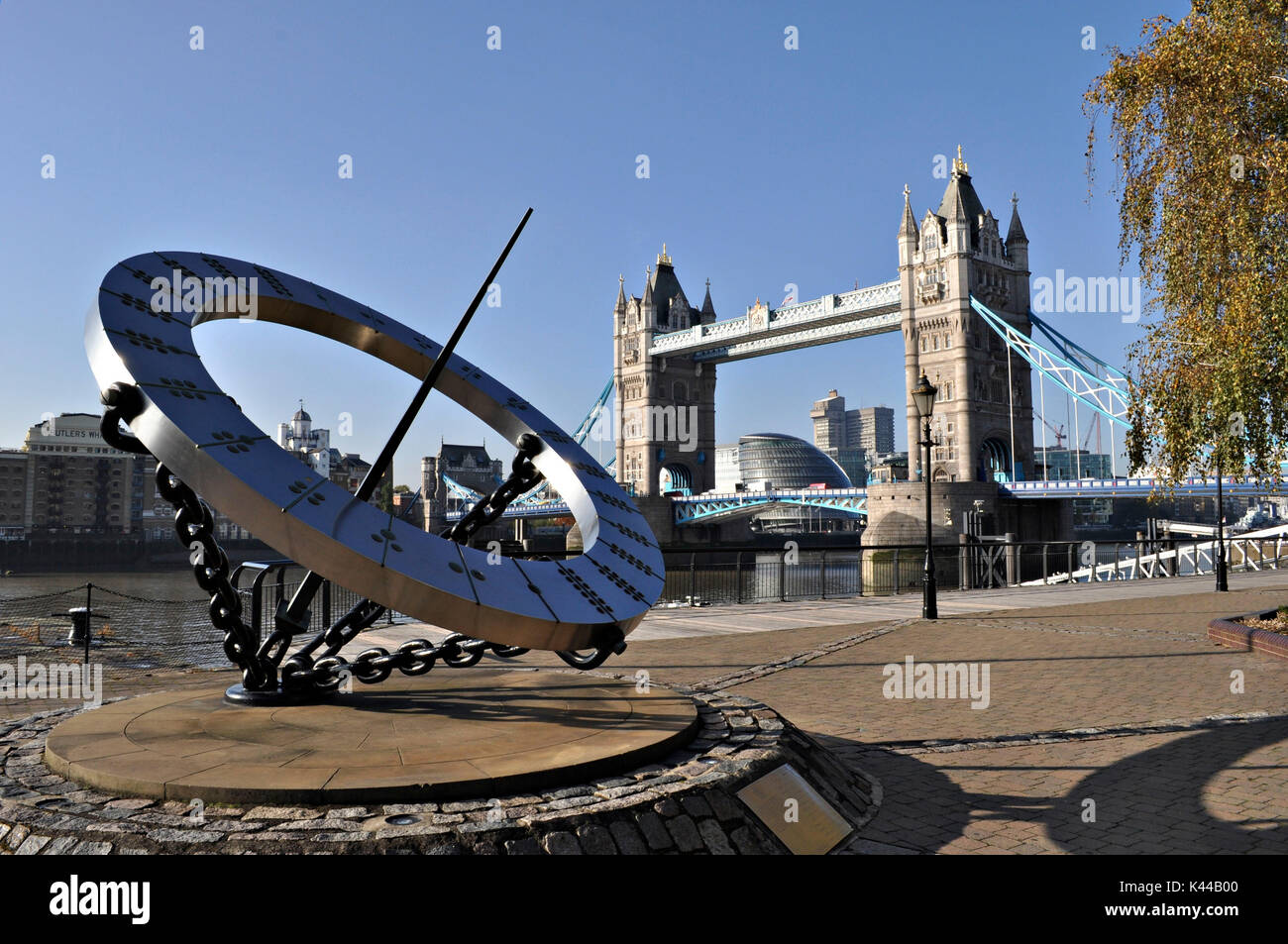 The Tower Bridge and the Timepiece sculpture, depicting a sundial, Wendy Taylor. Symbol of the city of London, this - Stock Image