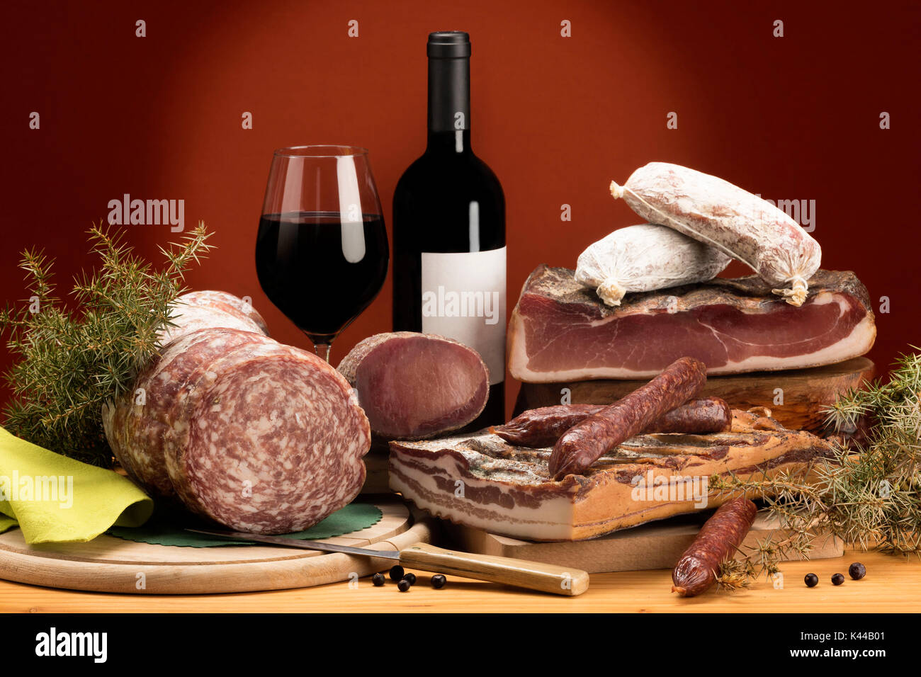 Still life, mixed salami, typical products, red wine, Trentino, AltoAdige, Dolomites, food, Stock Photo