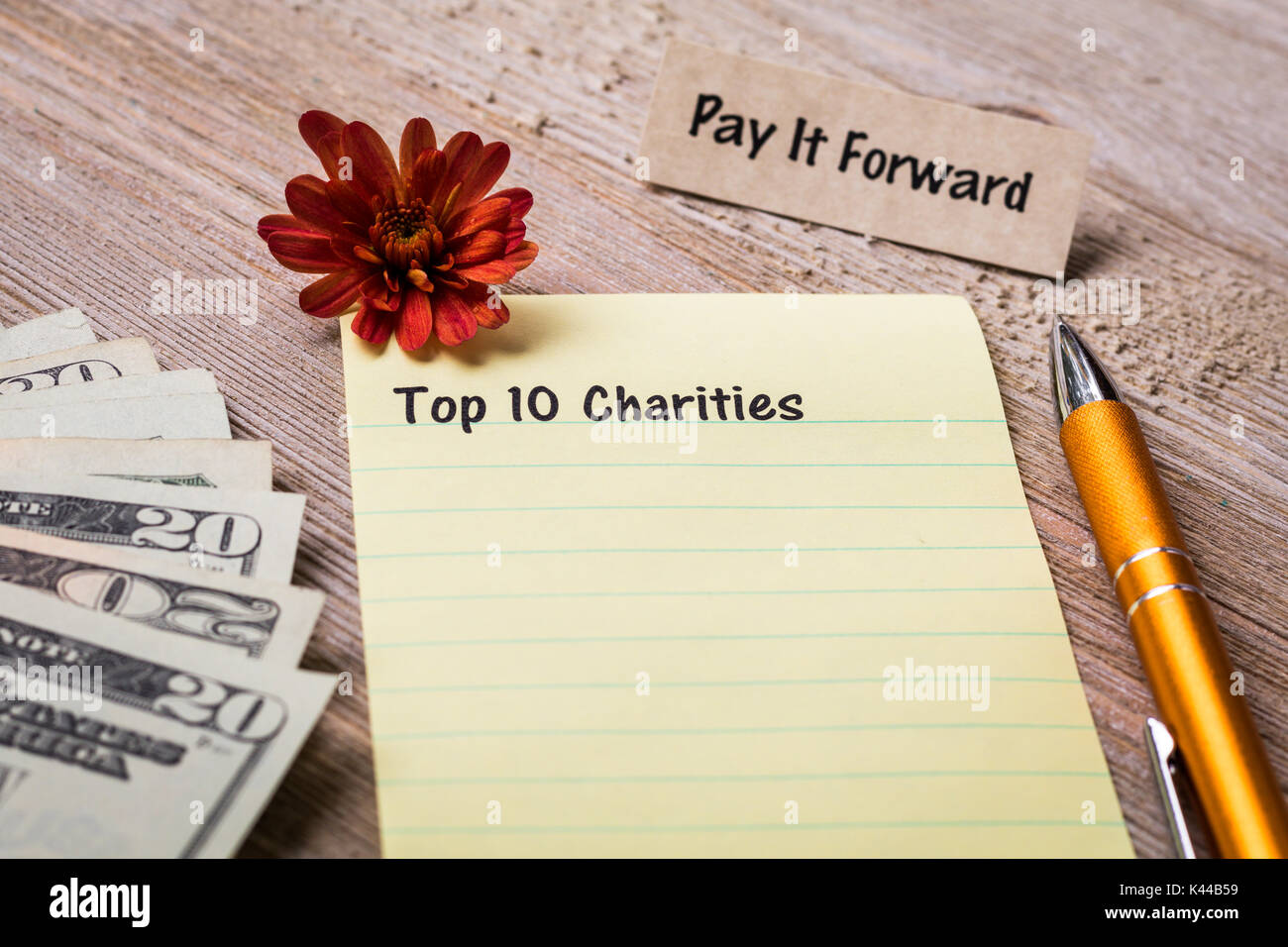 Charity and Donation concept on notebook and wooden board Stock Photo