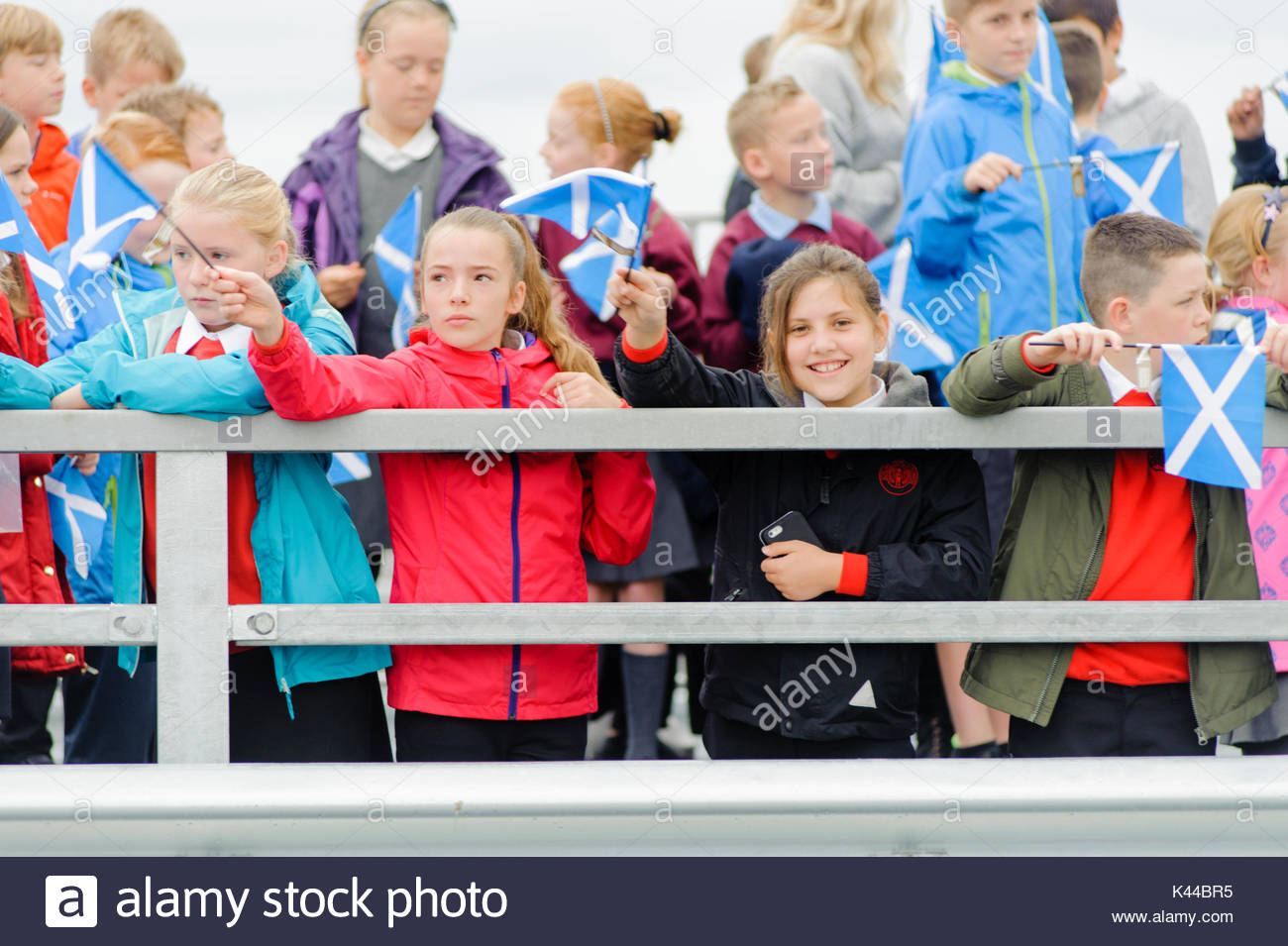 South Queensferry, UK. 4 September, 2017. Excited schoolchildren await the arrival of the Royal party.  The Queen accompanied by Prince Philip officially opens the New Queensferry Crossing on the 53rd anniversary of the day she opened the original Forth Road Bridge.  Credit: Roger Gaisford/Alamy Live News. - Stock Image