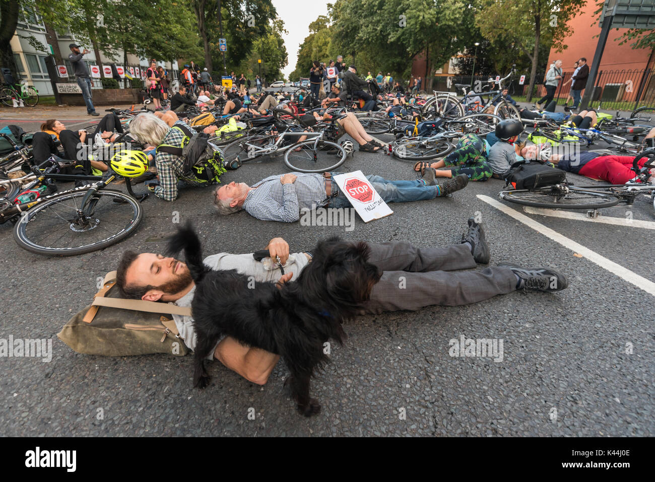 London, UK. 5th Sep, 2017. Stop Killing Cyclists observe a 10 minute silent die-in blocking the Camden Rd at the Stock Photo