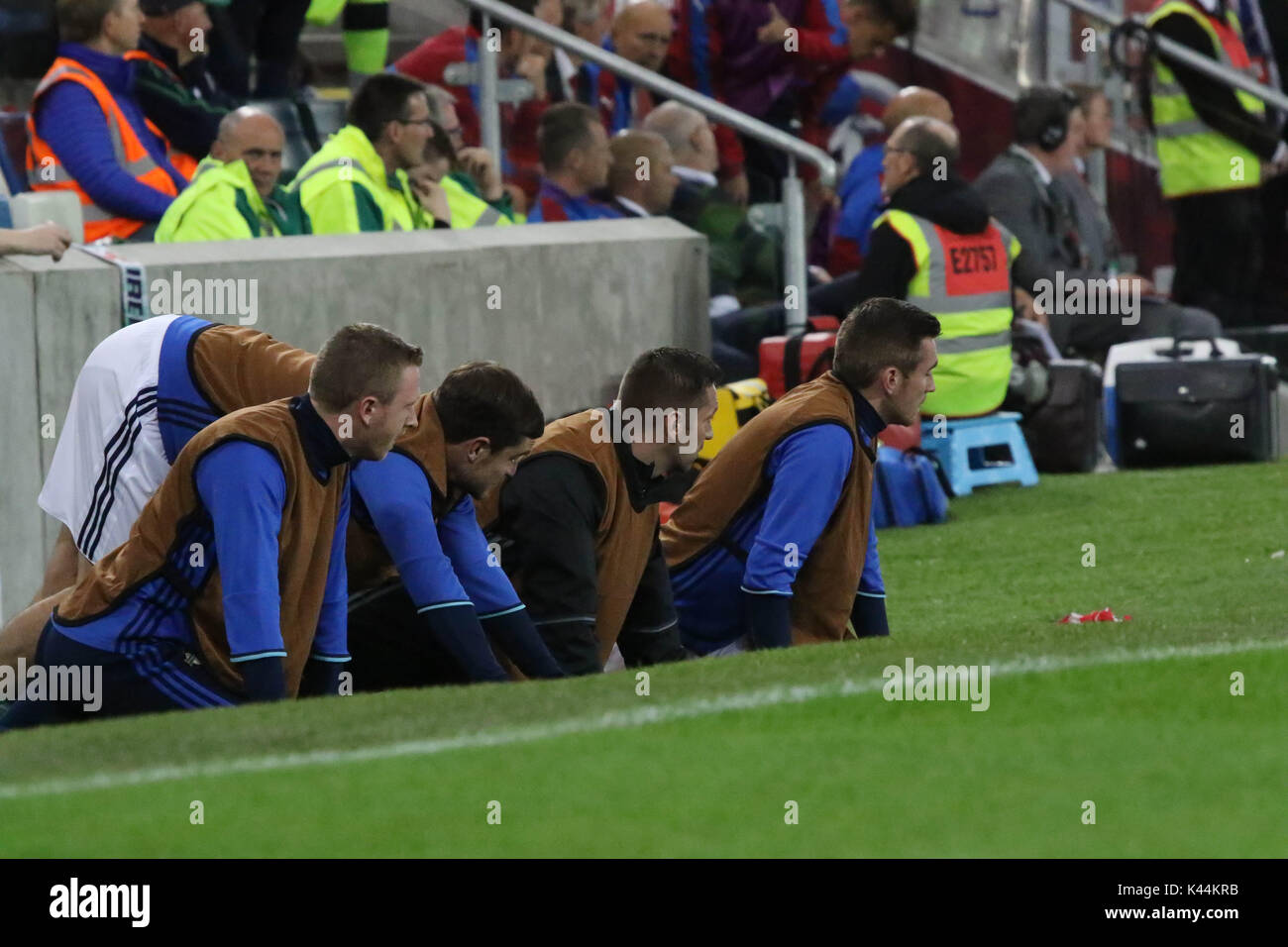 National Football Stadium at Windsor Park, Belfast, Northern Ireland. 04 September 2017.2018 World Cup Qualifier - Northern Ireland v Czech Republic. The Northern ireland substitutes watch the match unfold during their warm-up. Credit: David Hunter/Alamy Live News. - Stock Image