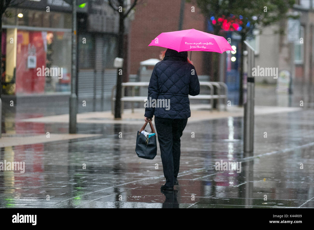 Southport, Merseyside. 5th Sept, 2017. UK Weather. Rainy, wet, blustery day at the resort heralds a big change to weather conditions with persistent heavy showers forecast for the north-west. Credit; MediaWorldImages/AlamyLiveNews - Stock Image