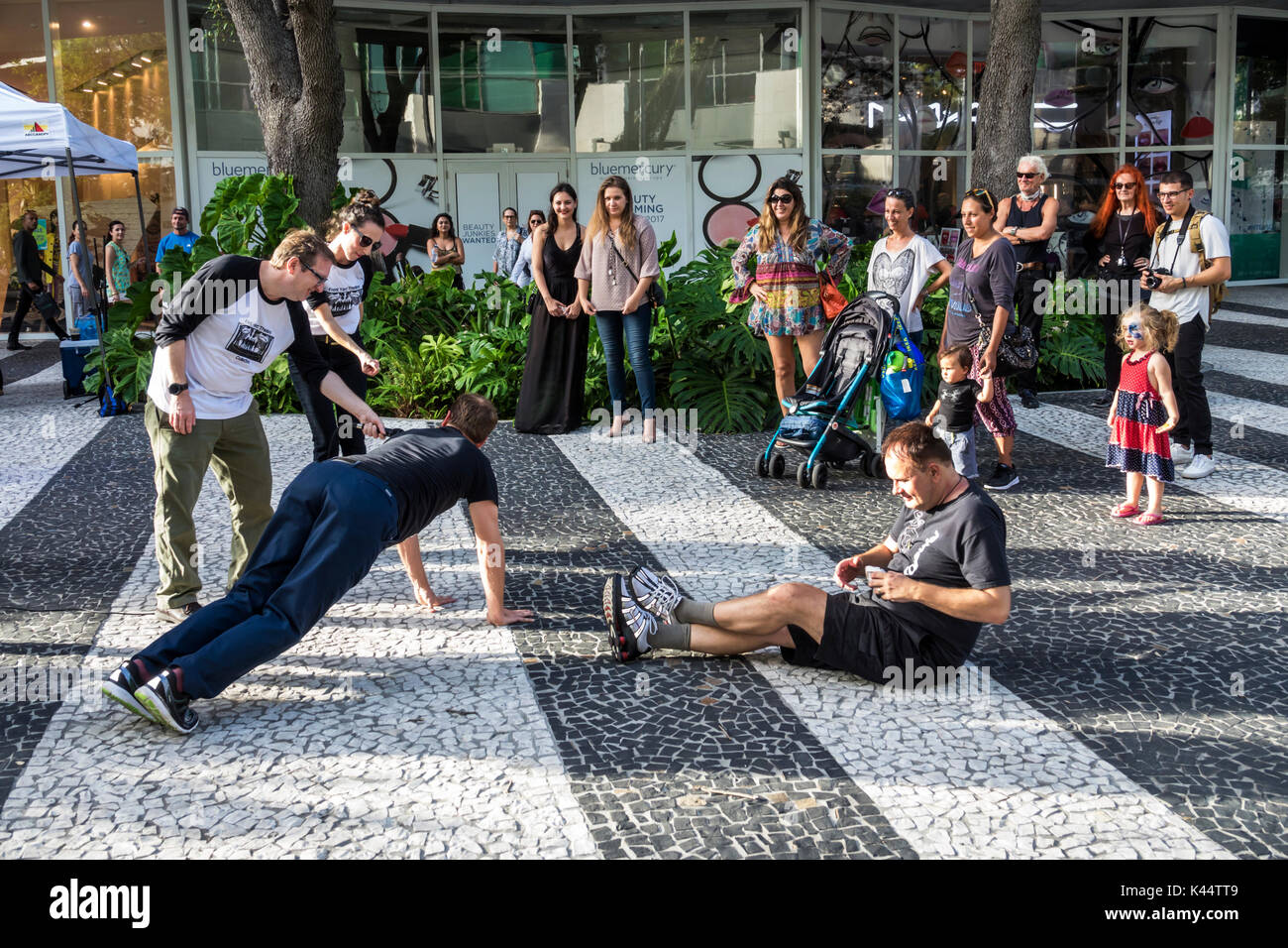 Miami Beach Florida Lincoln Road Mall pedestrian actors acting improv impromptu street free entertainment watching humor humour - Stock Image