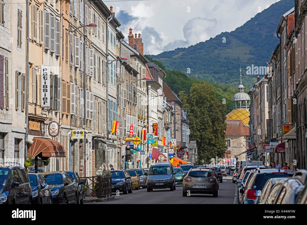 Old houses and shops in main street of the town Salins-les-Bains, commune in the Jura department in Franche-Comté, Lons-le-Saunier, France - Stock Image