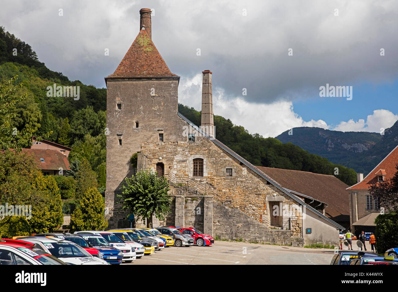 Rally cars of the Rallye du Sel in front of the Grande saline, old salt factory at Salins-les-Bains, Jura, Franche-Comté, Lons-le-Saunier, France - Stock Image