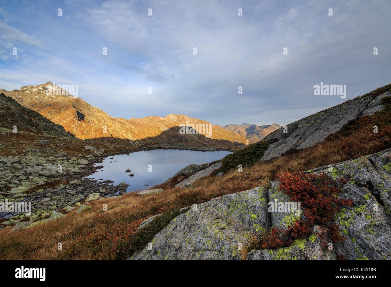 Peak Tambò and Lake Bergsee at dawn Chiavenna Valley Spluga Valley Switzerland Europe - Stock Image