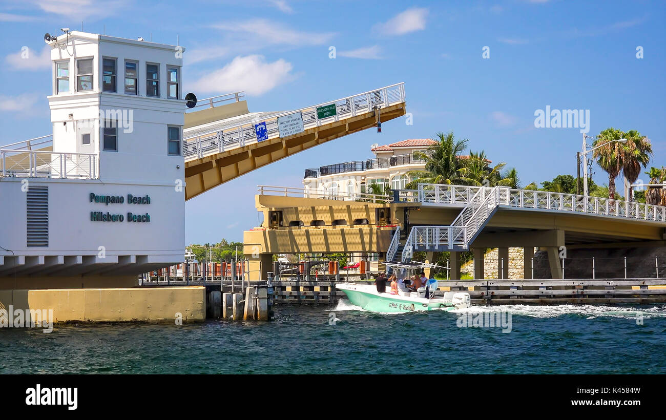 Drawbridge opens to let boats pass on intracoastal waterway in Pompano Beach, Florida - Stock Image