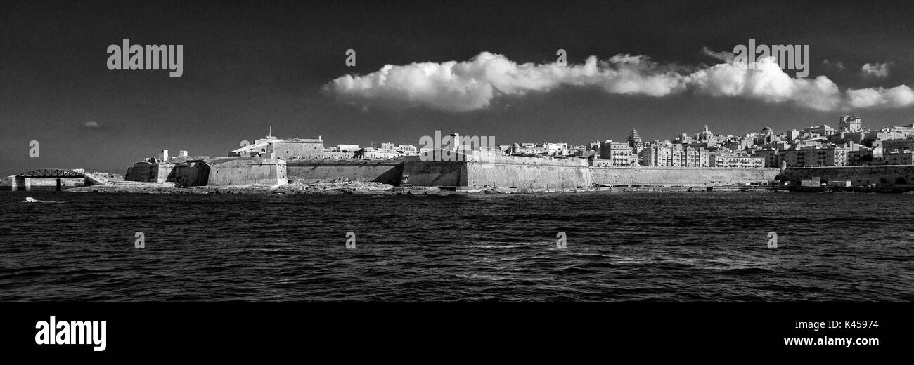 Black and white photograph of Fort St Elmo, in Valletta, capital of Malta, from Marsamxett Harbour - Stock Image