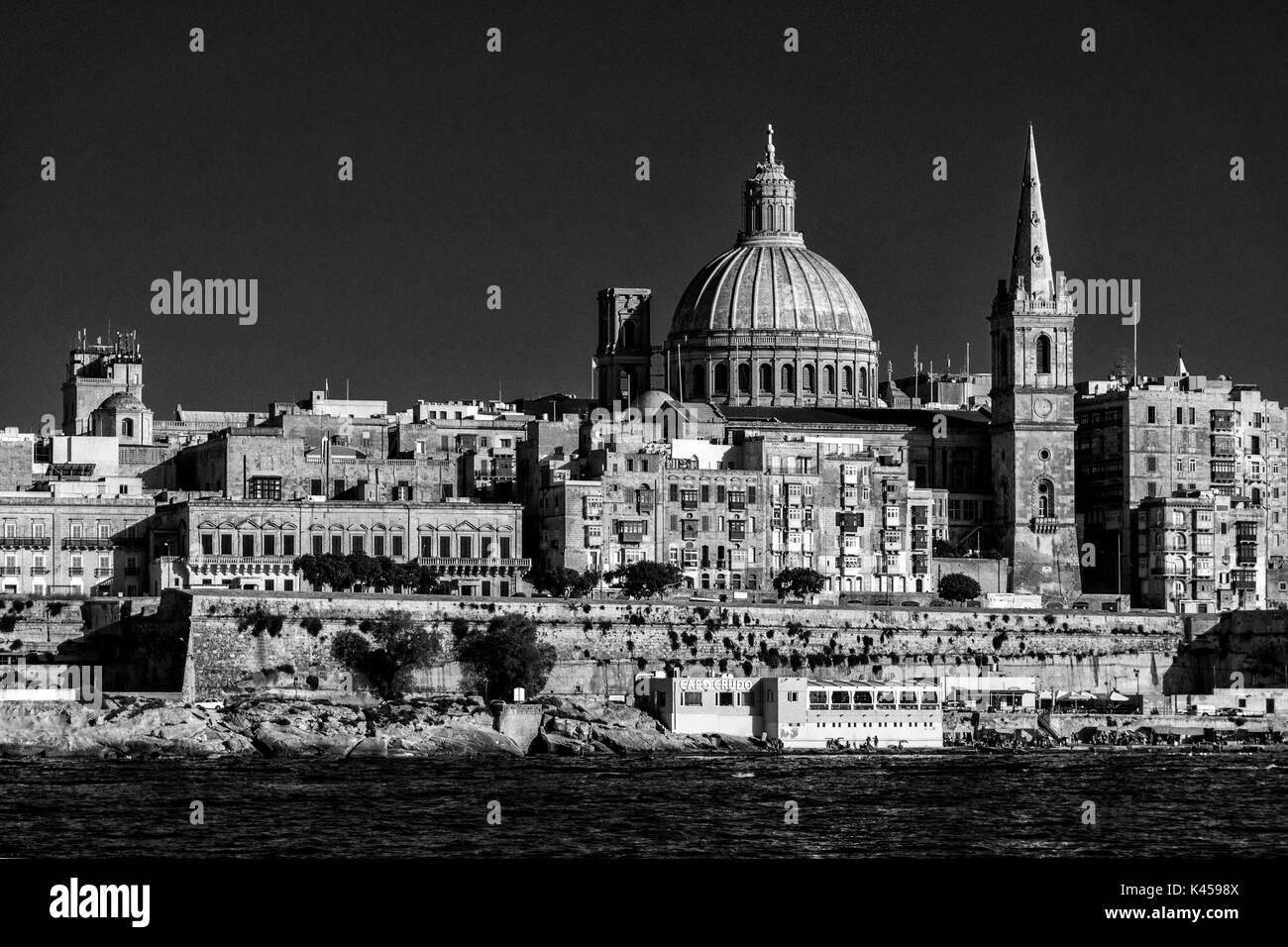 Black and White scenic summer view of Valletta, capital of Malta, across from Sliema, looking over Marsamxett Harbour - Stock Image
