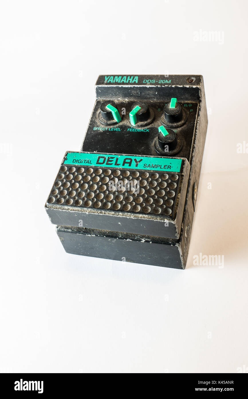 Vintage Yamaha digital delay pedal on neutral background - Stock Image