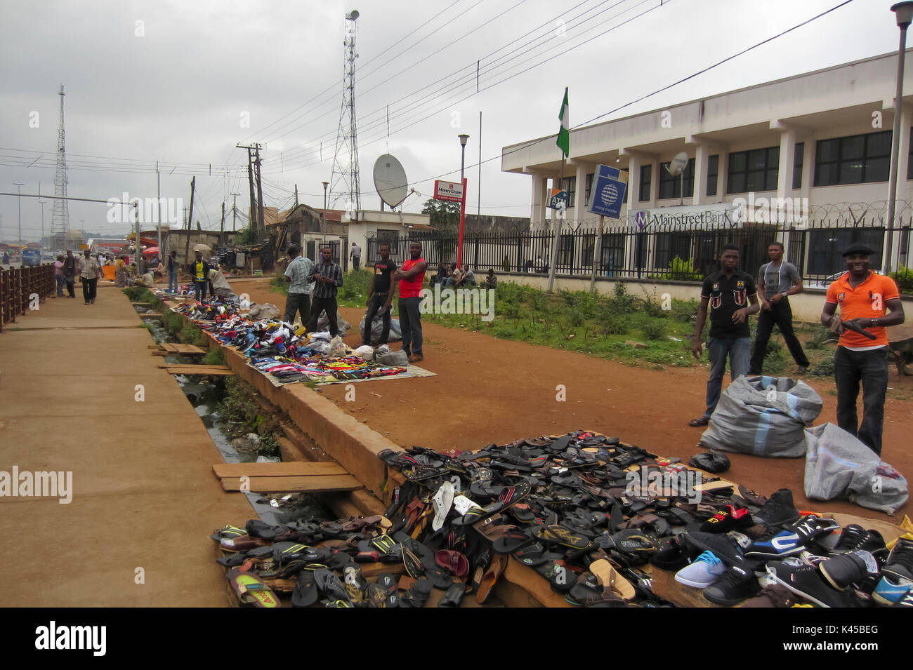 People selling shoes and sandals in the street in the city of Akure, a big conurbation in Ondo State, Nigeria - Stock Image