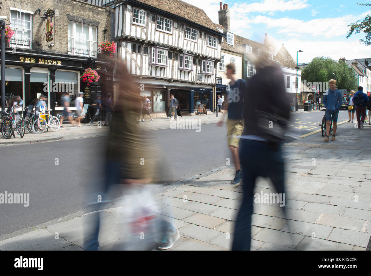 Active blur of people in cambridge walking along trumpington street in the city, blurred with plenty of movement Stock Photo