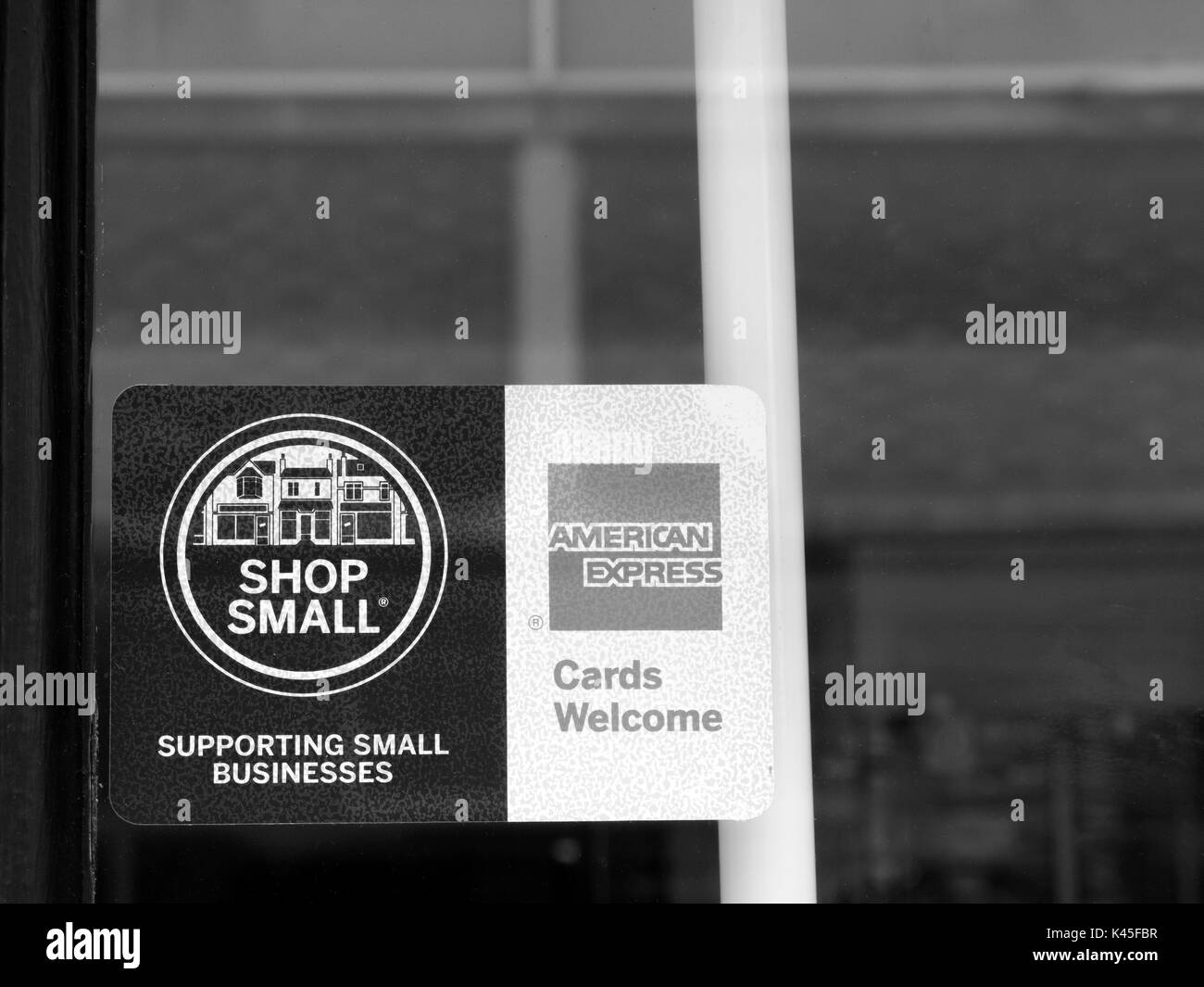 Shop small and american express cards welcome sign in retail shop shop small and american express cards welcome sign in retail shop window colourmoves