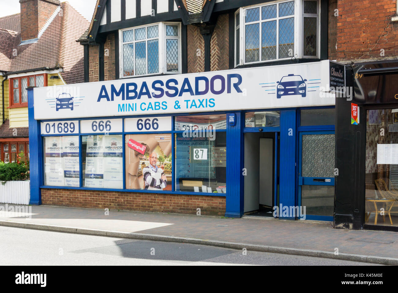 Ambassador Mini Cabs & Taxis in Orpington High Street. - Stock Image