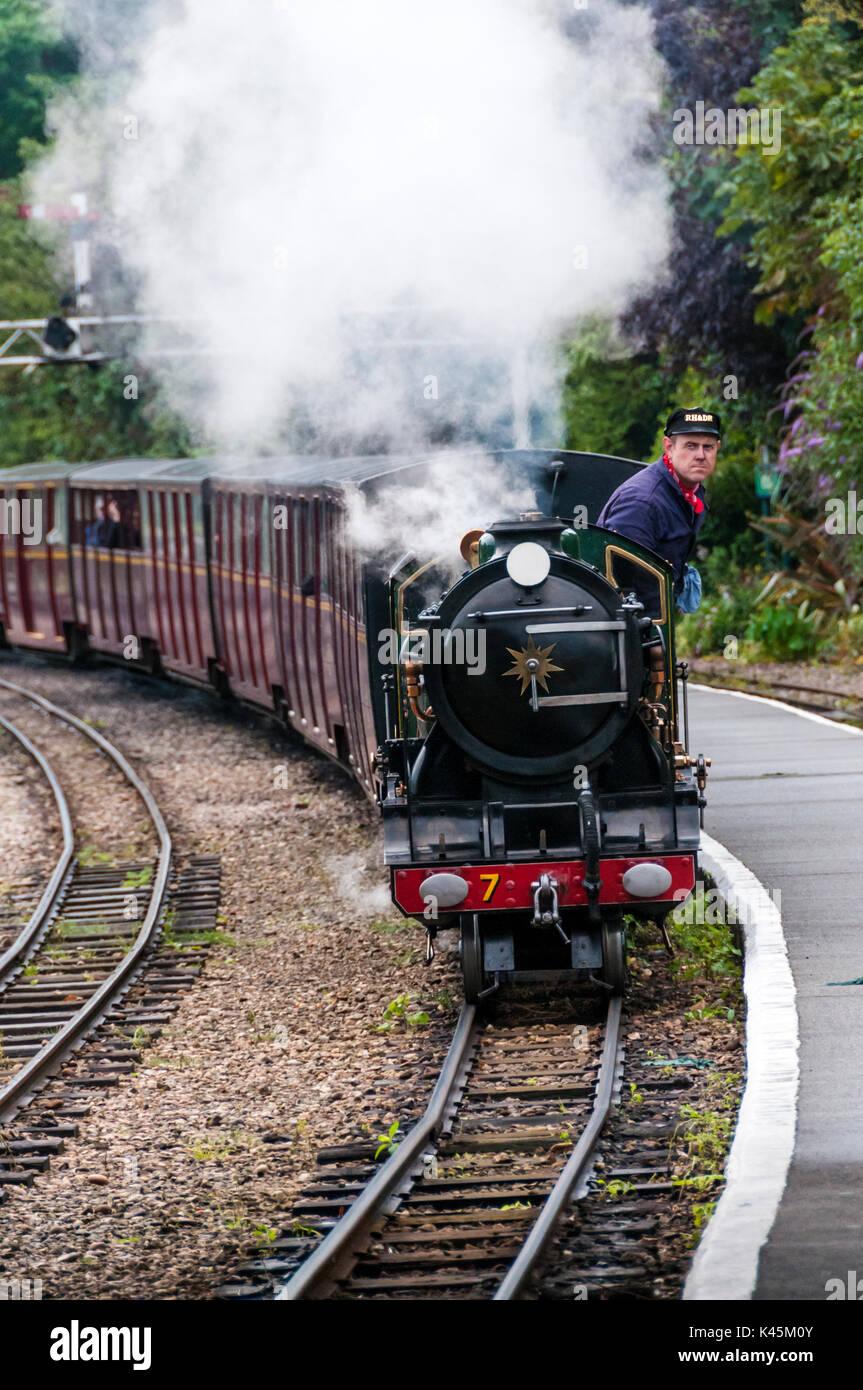 Locomotive 7 Typhoon of the Romney Hythe & Dymchurch Railway approaching Hythe station. - Stock Image