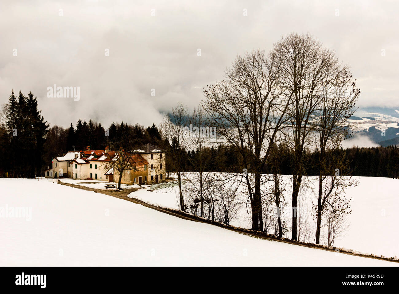 Tresche Conca, Altopiano of Asiago, Province of Vicenza, Veneto, Italy. Small hamlet in winter. - Stock Image