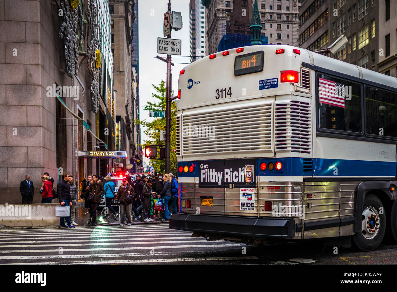 USA, New York, New York City, Mid-Town Manhattan, Filthy Rich bus sign by Trump Tower - Stock Image