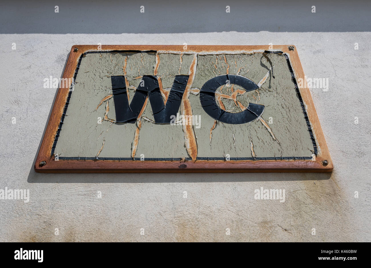 Weathered WC sign - Stock Image