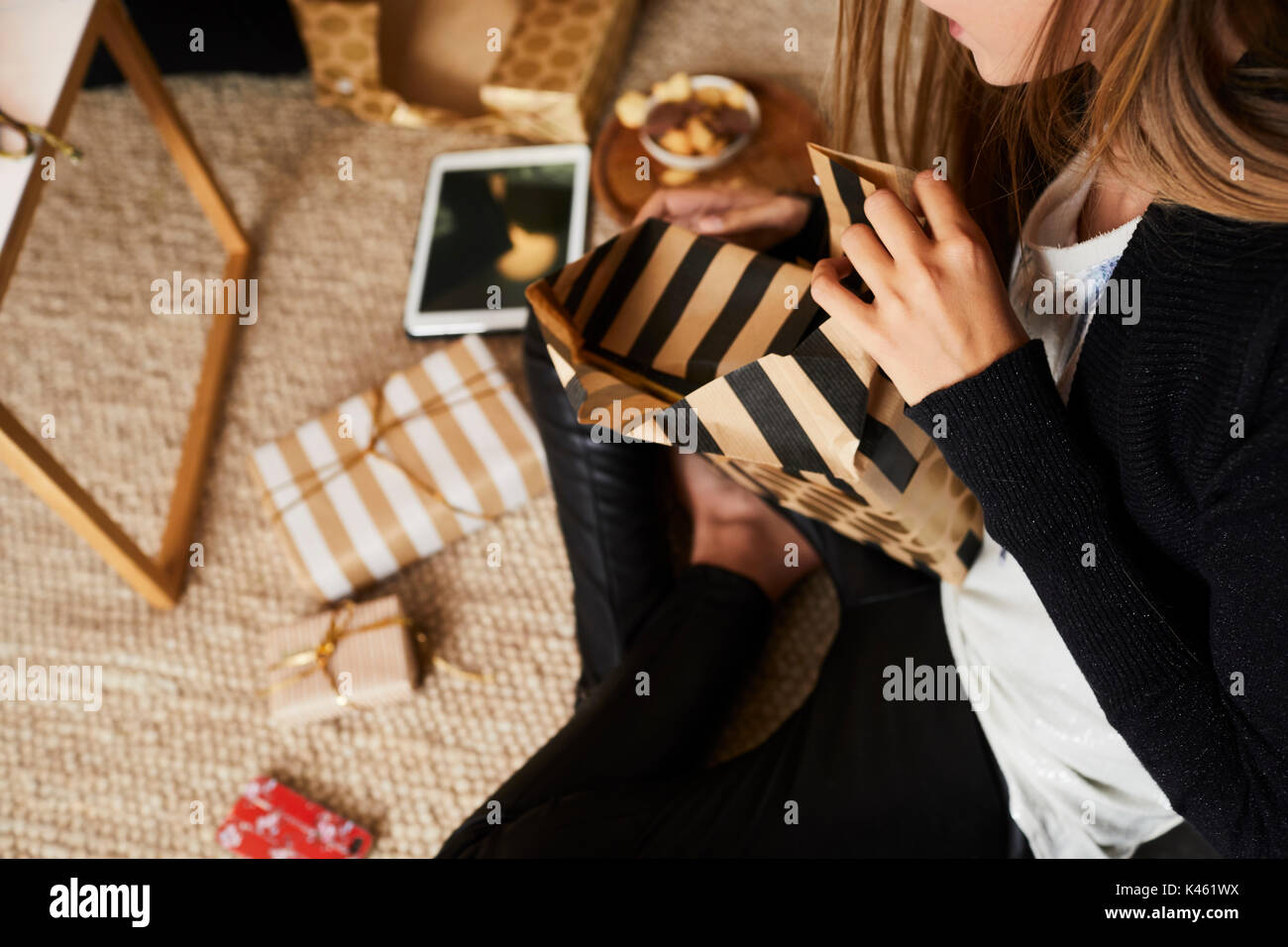 Girl at Christmas Eve, unpacking presents, detail - Stock Image